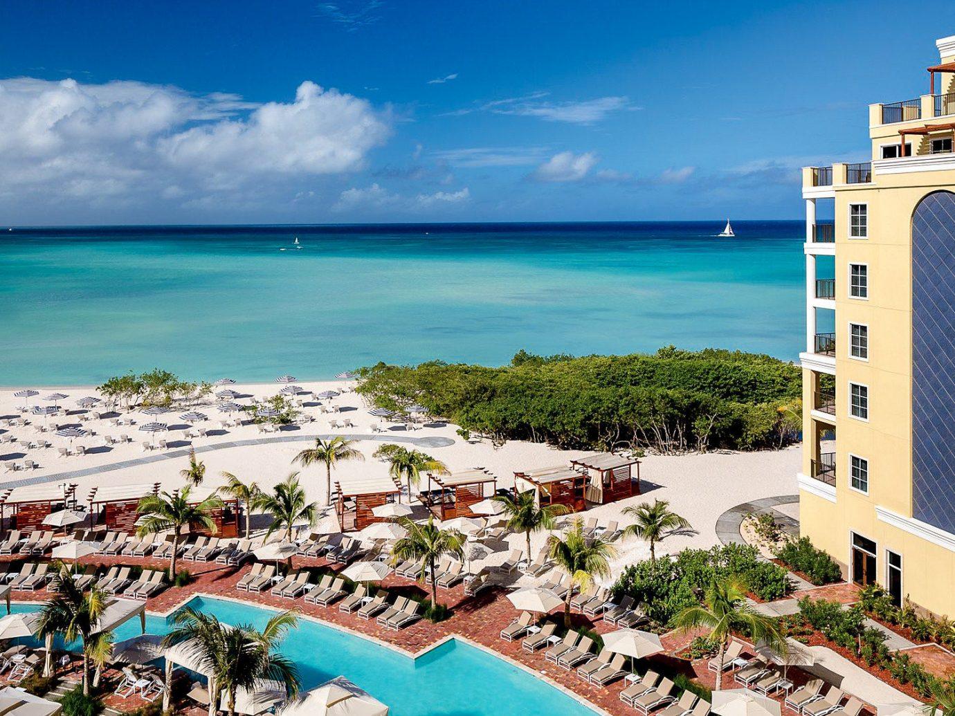 Hotels Romance sky water Resort outdoor vacation tourism Sea real estate Nature leisure Beach caribbean condominium Ocean hotel travel palm tree shore