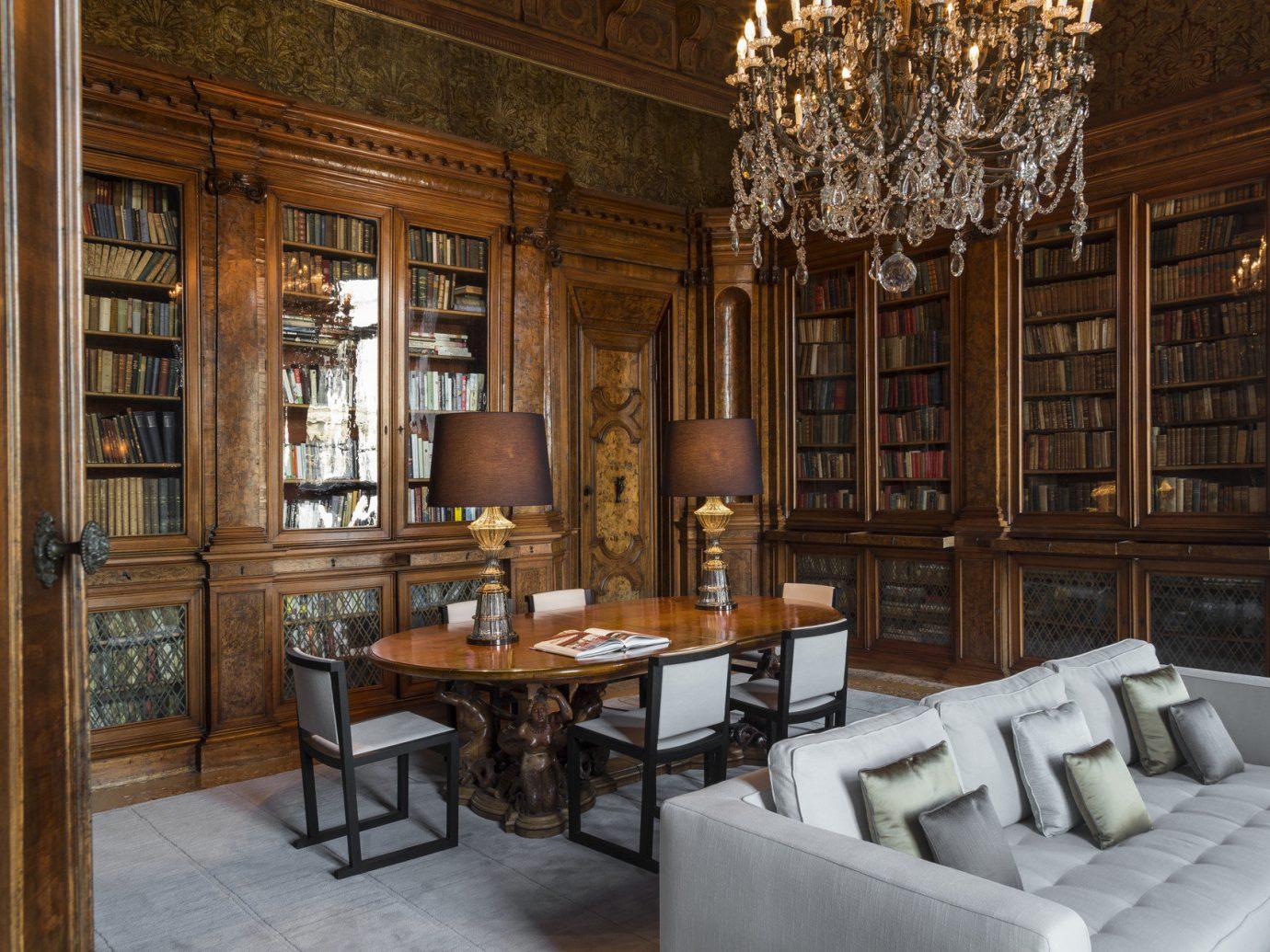 Hotels floor indoor room chair property Living dining room living room library estate home interior design furniture lighting wood Design cabinetry mansion