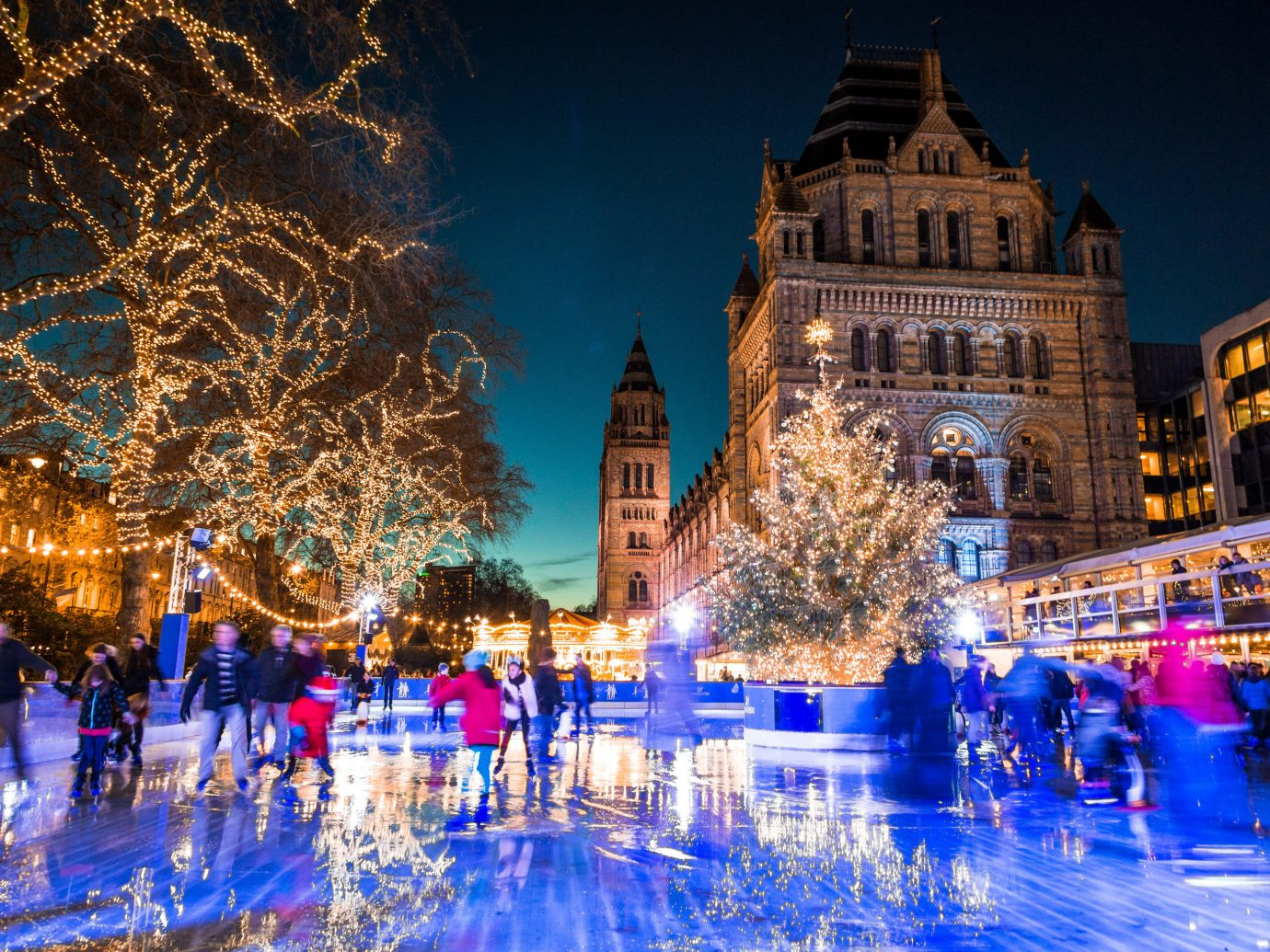 Trip Ideas building outdoor night tree group Christmas christmas decoration Christmas tree christmas lights Winter Resort evening ice rink holiday amusement park plaza cityscape several