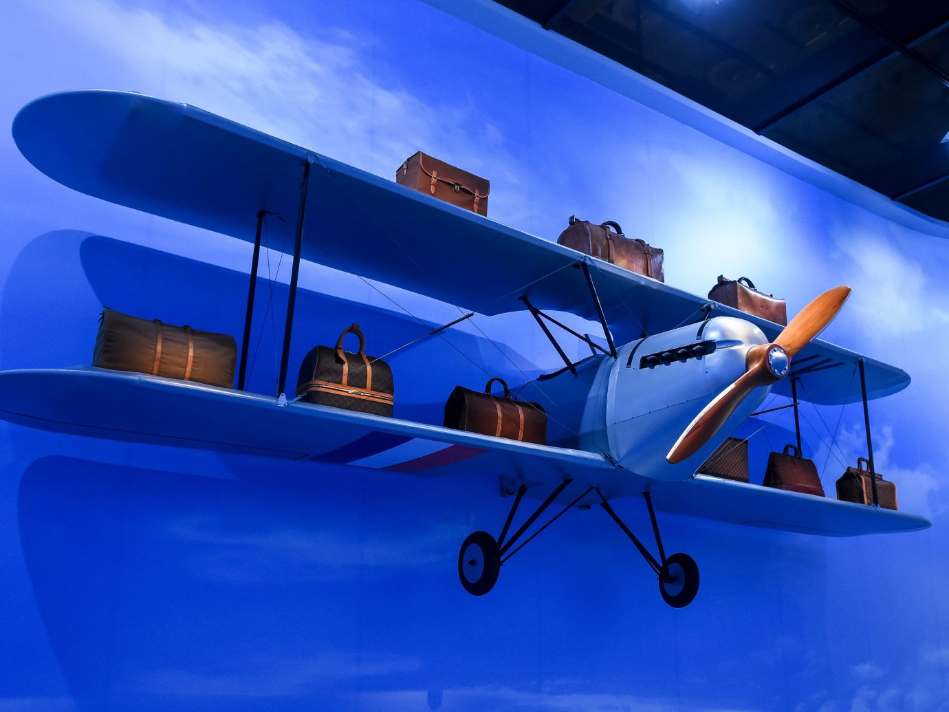 News Style + Design sky blue airplane aircraft plane aviation air travel aerospace engineering light aircraft wing propeller biplane propeller driven aircraft flight general aviation monoplane computer wallpaper engine