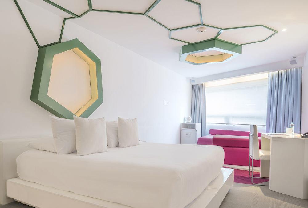 Bedroom Design Hip Hotels indoor wall floor room property ceiling interior design living room furniture Suite estate real estate cottage apartment