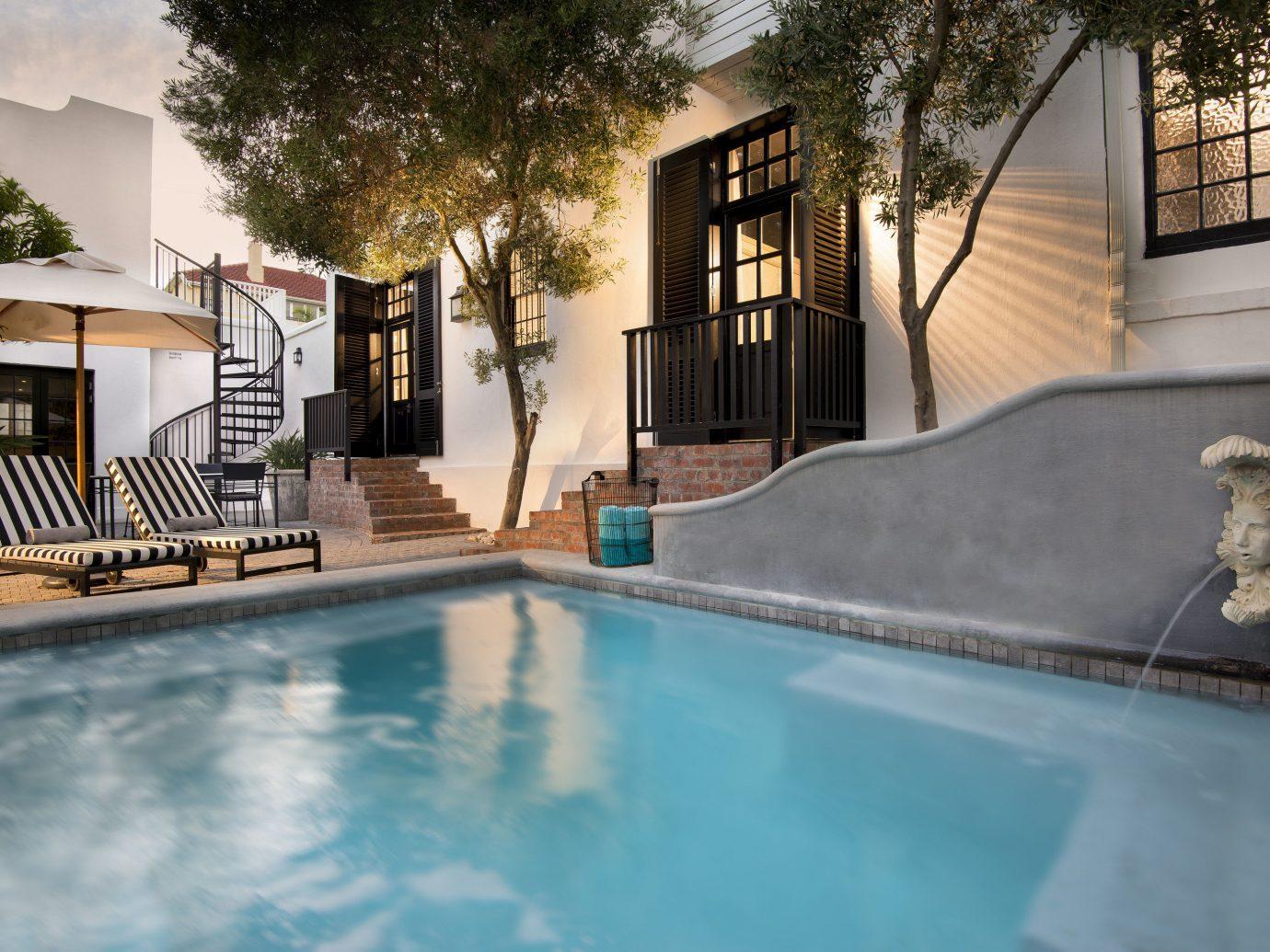Hotels outdoor swimming pool property estate house home backyard Villa mansion Resort real estate condominium Courtyard