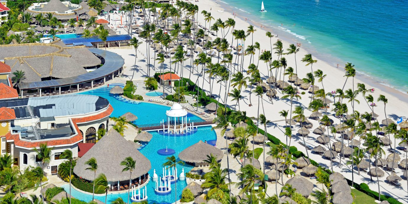 All-inclusive Beach Beachfront Exterior Family Luxury Pool Resort Romantic Scenic views Travel Tips Waterfront leisure Water park marina bird's eye view vacation amusement park aerial photography park resort town residential area Coast dock Sea lined