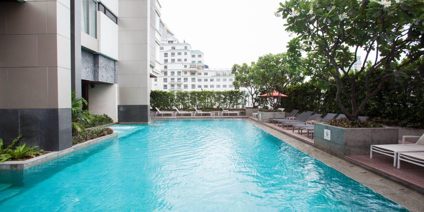 Pool water swimming swimming pool property Resort leisure condominium reflecting pool blue Villa backyard empty