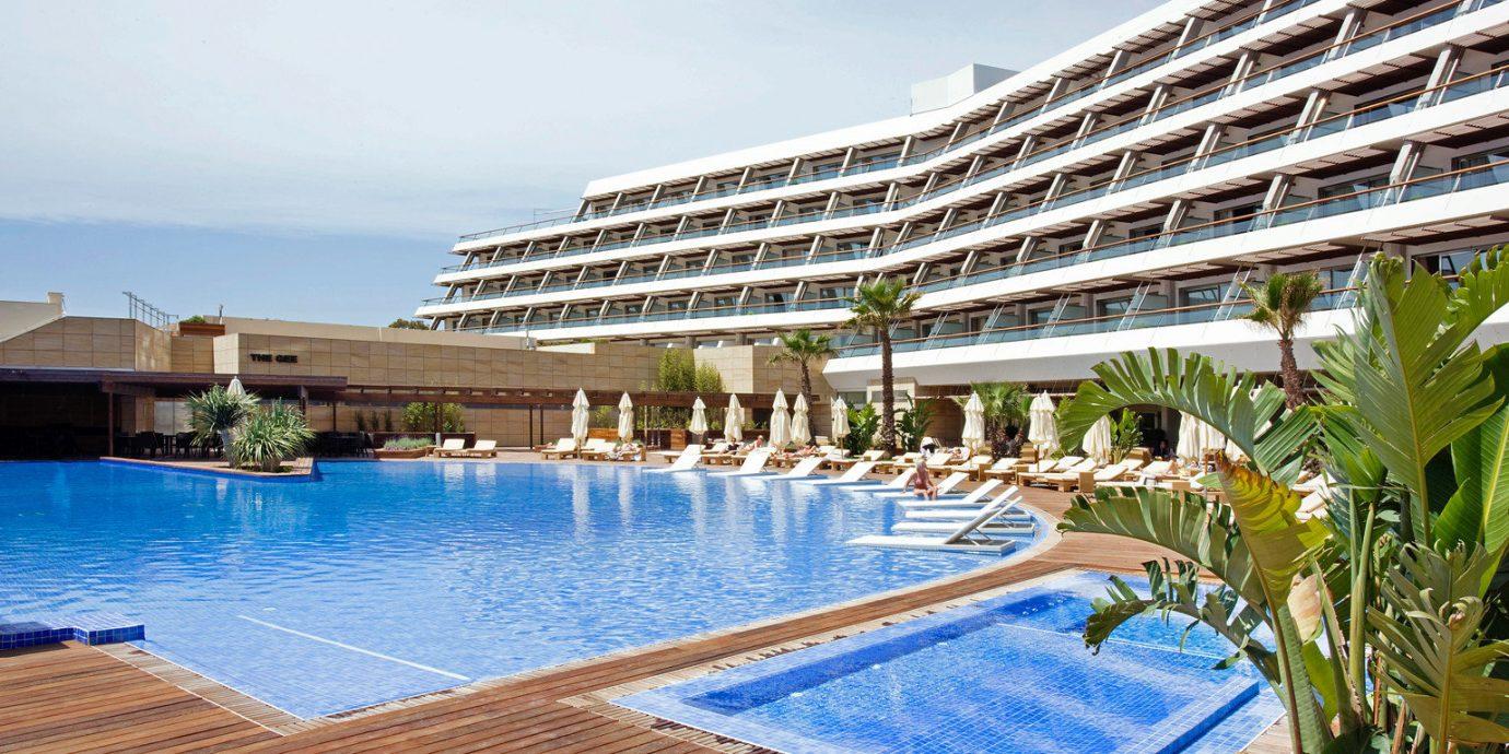 sky building swimming pool Resort chair property leisure Pool lawn condominium Villa palace swimming sandy