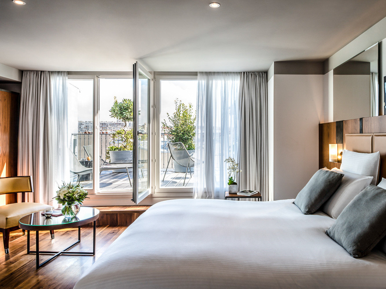 Boutique Hotels Hotels Jetsetter Guides Luxury Travel indoor bed ceiling wall room window floor hotel Bedroom interior design Suite real estate home penthouse apartment interior designer window treatment condominium estate nice living room bed frame
