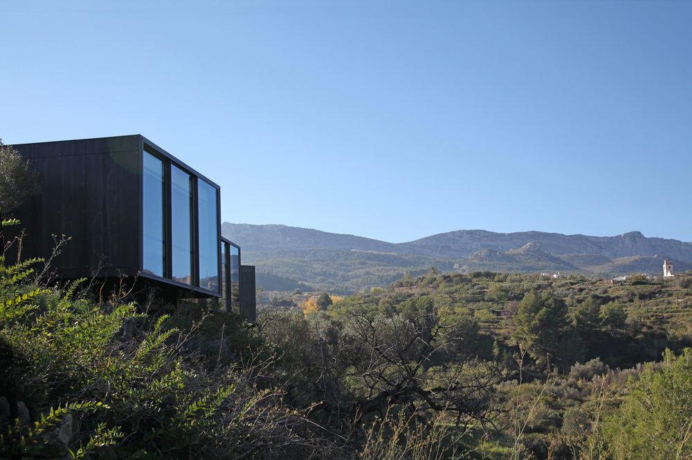 Hotels outdoor sky grass mountain mountainous landforms building hill rural area landscape hillside lush