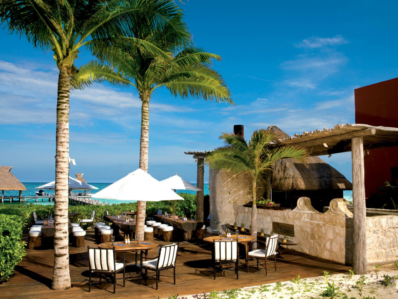 Beach Beachfront Deck Dining Hotels Living Lounge tree outdoor chair property vacation Resort hacienda estate arecales wooden tourism Villa caribbean area plant furniture
