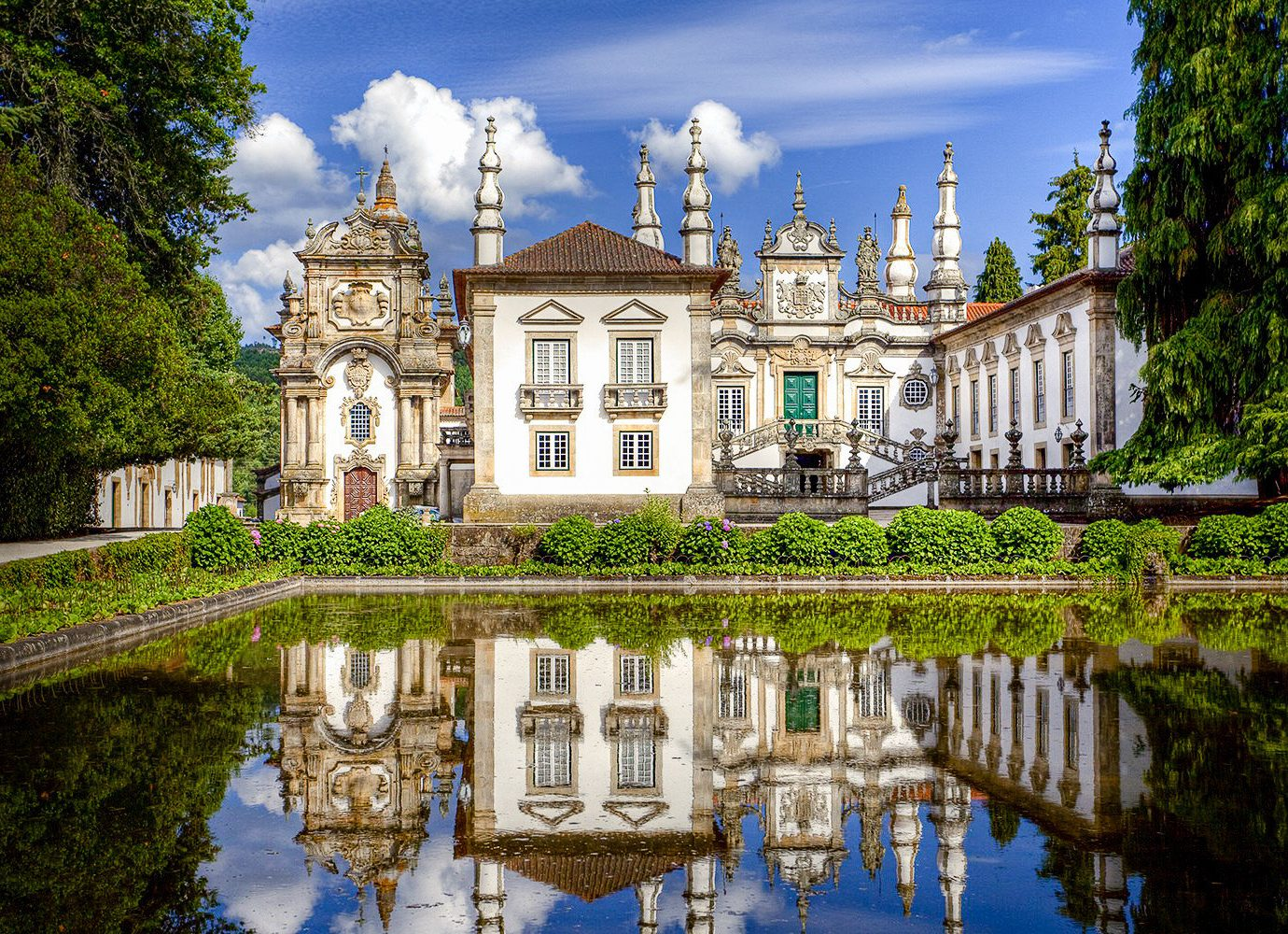 Cruise Travel Luxury Travel tree outdoor reflection Nature water château landmark sky waterway estate stately home mansion national trust for places of historic interest or natural beauty tourist attraction palace watercourse building water castle Villa home real estate manor house facade historic site tourism house landscape old government building stone