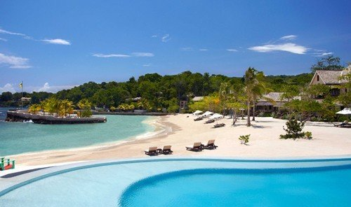 Hotels water sky outdoor swimming pool Resort property Boat reef Nature caribbean leisure vacation Beach bay resort town Lagoon estate swimming Water park Villa real estate shore day