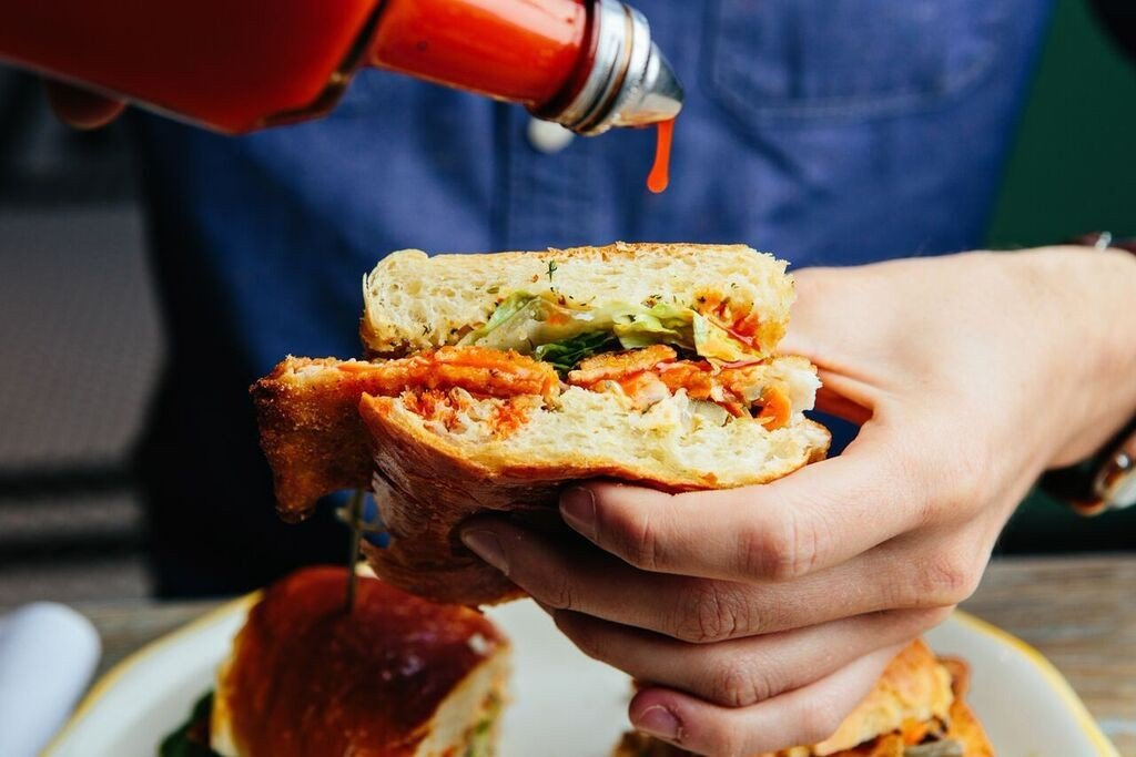 Food + Drink person food dish sandwich meal cuisine breakfast produce sense restaurant fast food lunch meat hand snack food