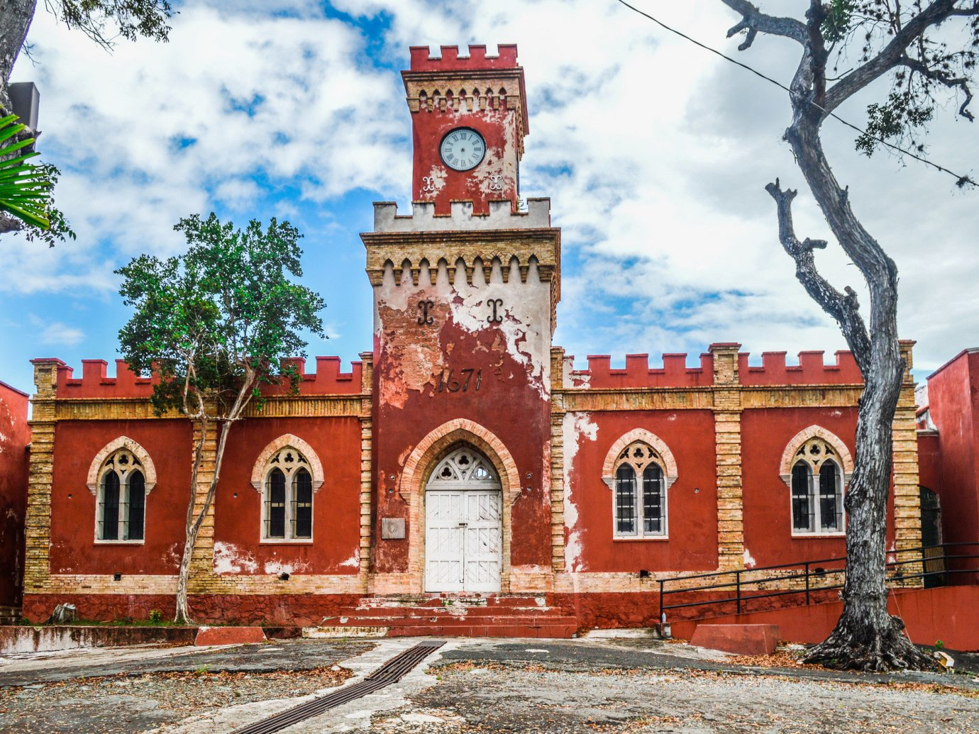 Trip Ideas outdoor tree sky building landmark Town brick Architecture old tourism red place of worship ancient history facade Church arch tower synagogue travel stone surrounded