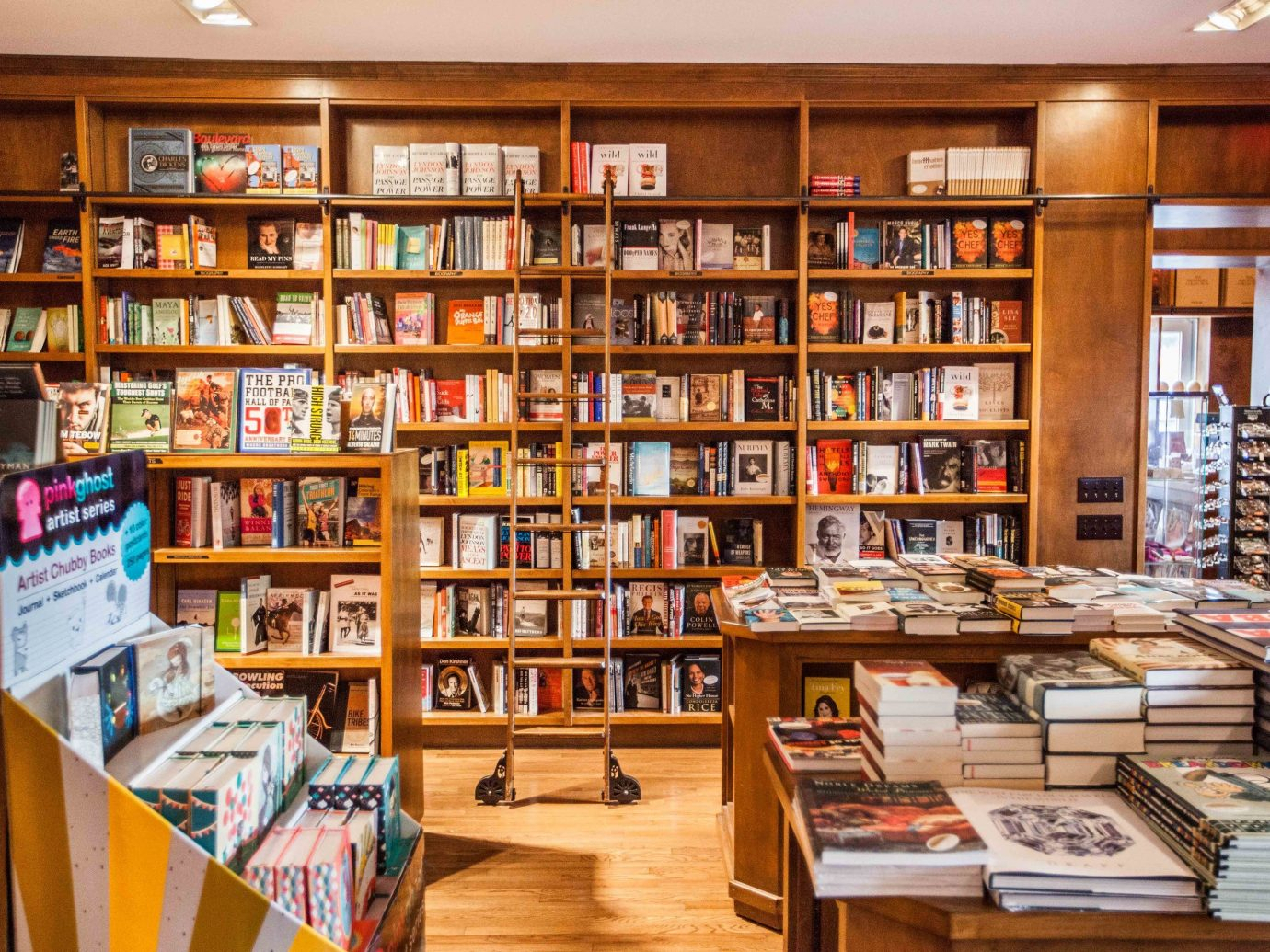 Offbeat shelf indoor book bookselling library public library scene retail room building grocery store Shop