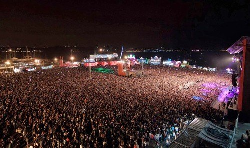 Jetsetter Guides crowd rock concert performance people concert audience stage event festival light arena stadium night