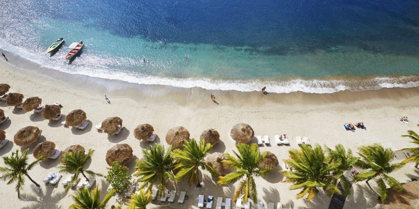 Hotels Offbeat Romance Travel Tips water Beach Ocean Sea caribbean Coast shore vacation Nature wave tropics sand sandy several