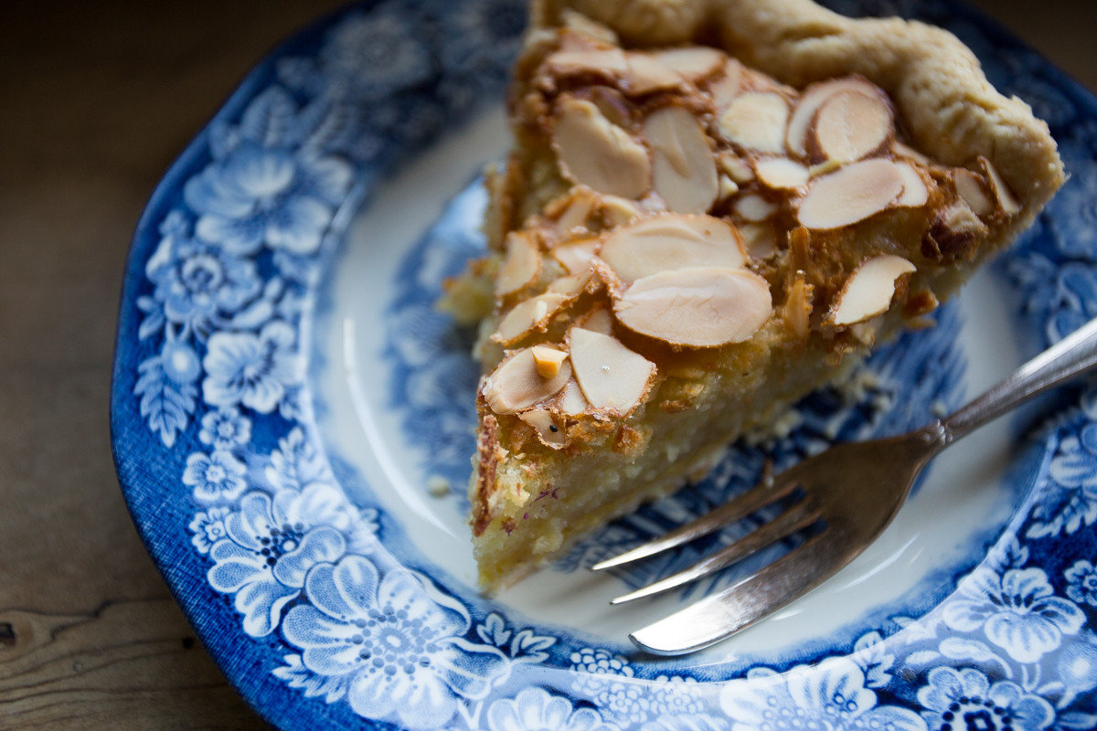 almond dessert Eat food Food + Drink Offbeat pie sweets plate cake fork dish slice piece plant produce baked goods land plant breakfast blue fruit meal coconut chocolate flowering plant baking sliced