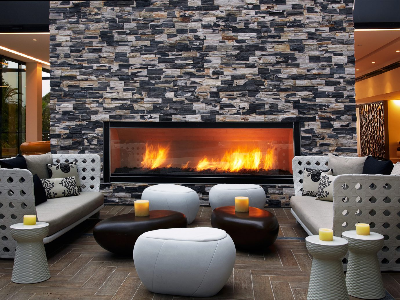 Fireplace Hip Hotels Lobby Lounge indoor Living hearth living room room wood burning stove home interior design floor Design cottage real estate furniture stone