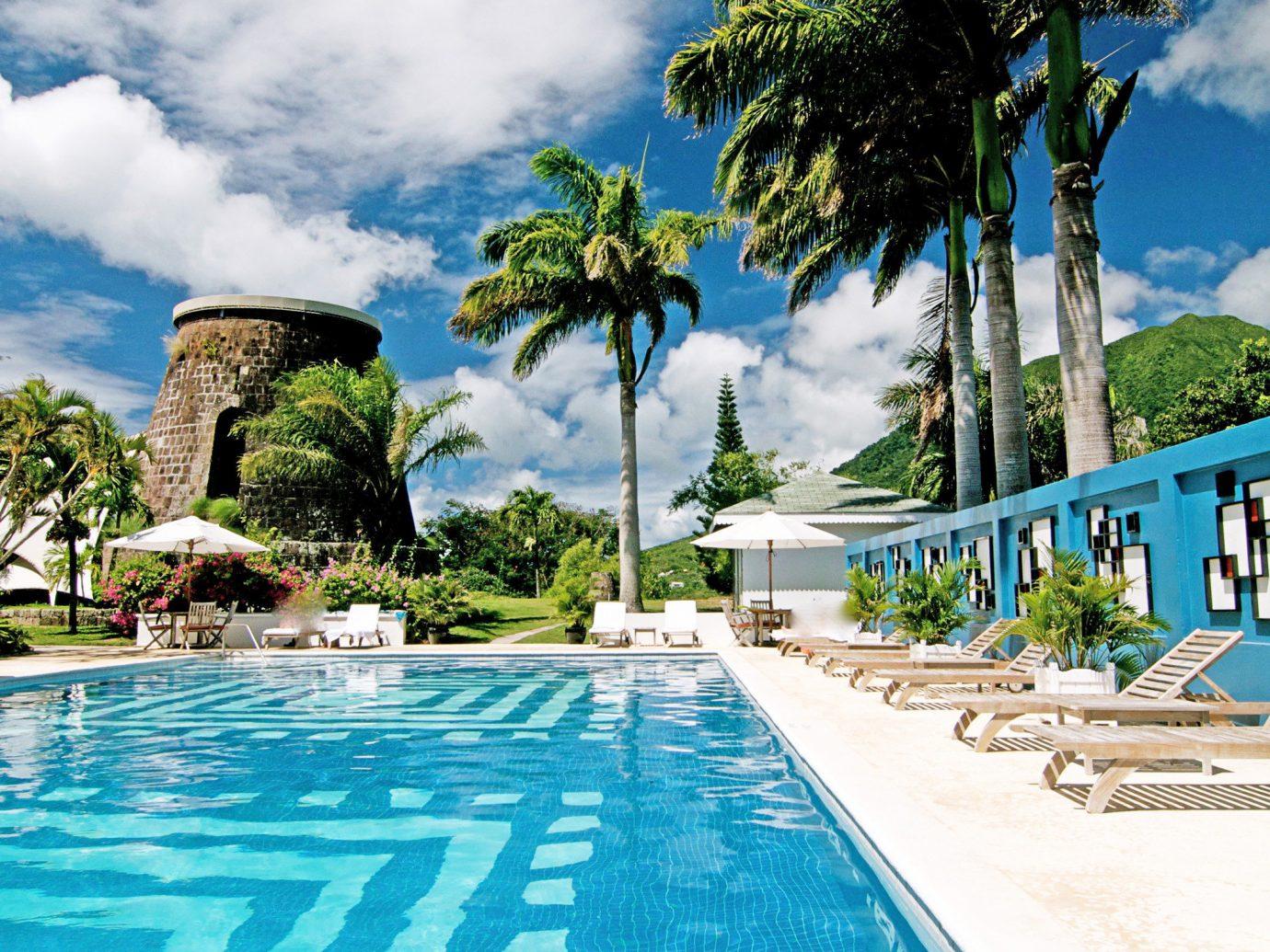 Island Landmarks Pool Trip Ideas tree outdoor sky swimming pool leisure Beach vacation caribbean Sea Ocean Resort arecales Coast tropics bay estate Lagoon walkway day