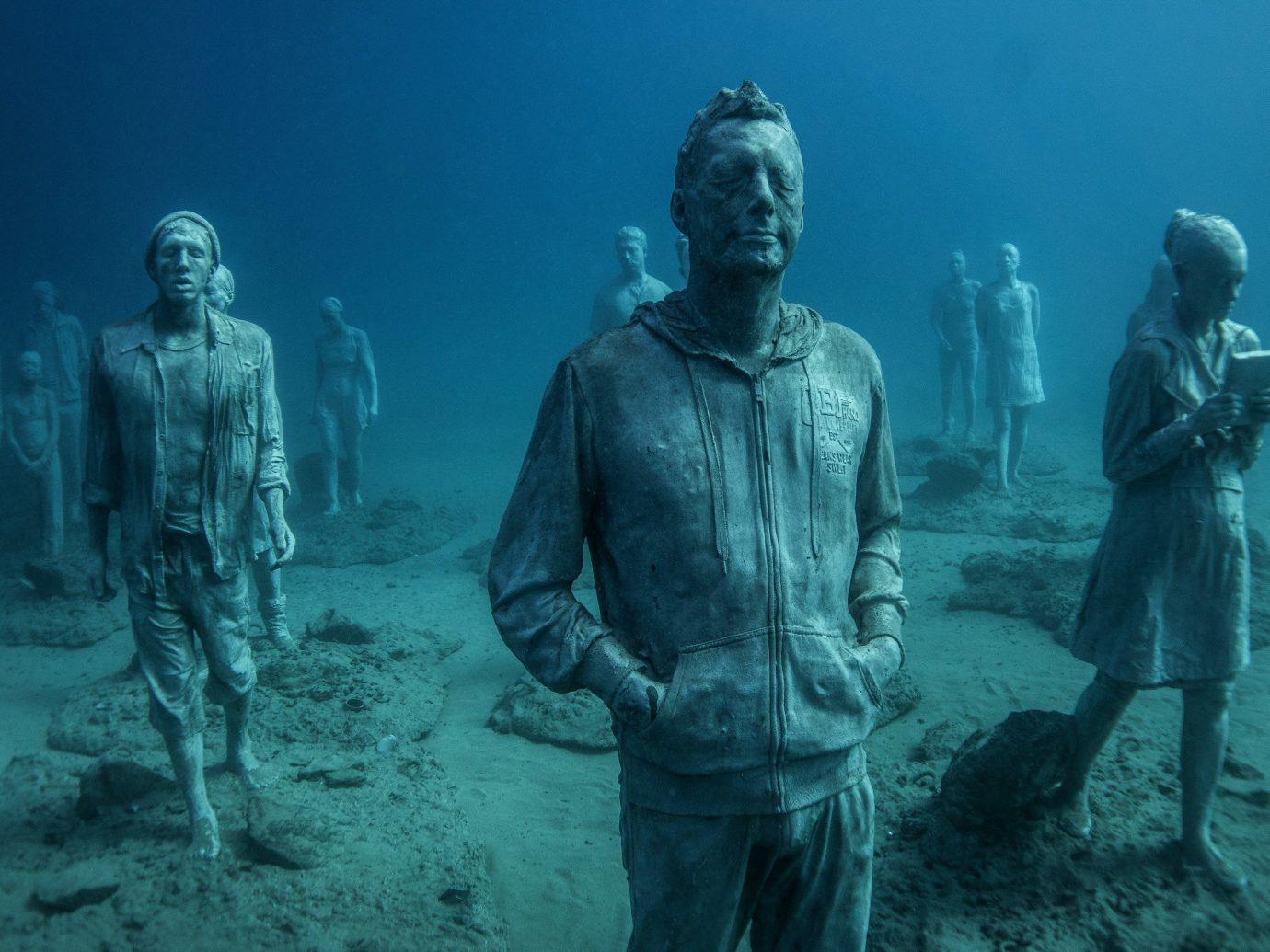 Scuba Diving + Snorkeling Trip Ideas ground man outdoor person standing underwater screenshot posing ocean floor