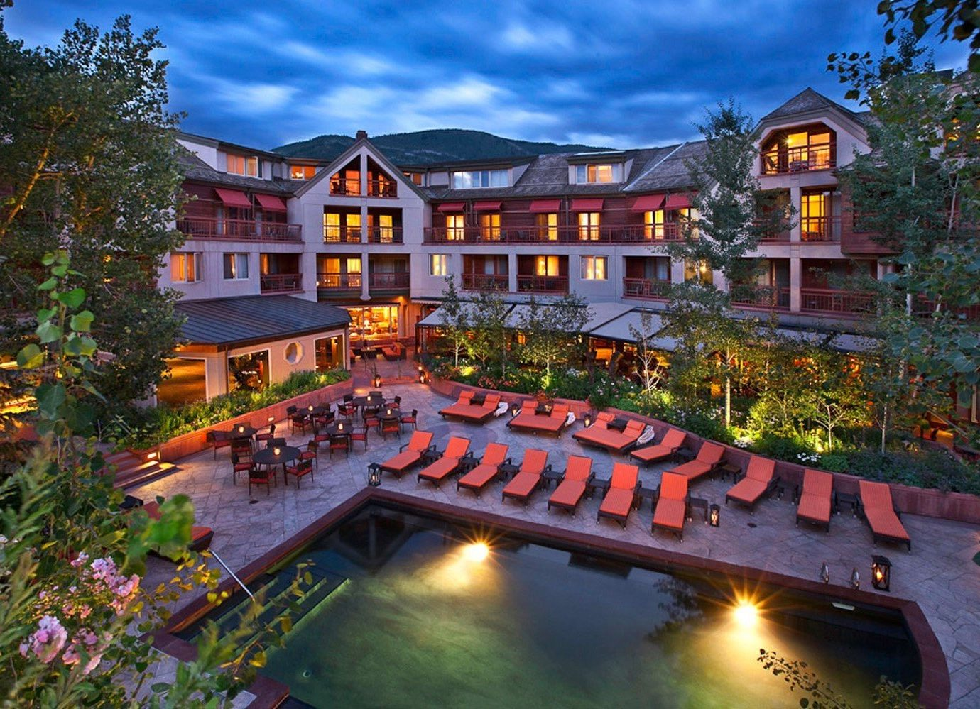 Mountains + Skiing Trip Ideas tree sky outdoor property estate house building Resort mansion home residential area backyard landscape lighting swimming pool colorful