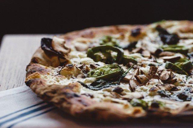 Food + Drink pizza food dish indoor slice cuisine meal produce cheese breakfast italian food vegetable quiche european food baked goods sliced eaten toppings