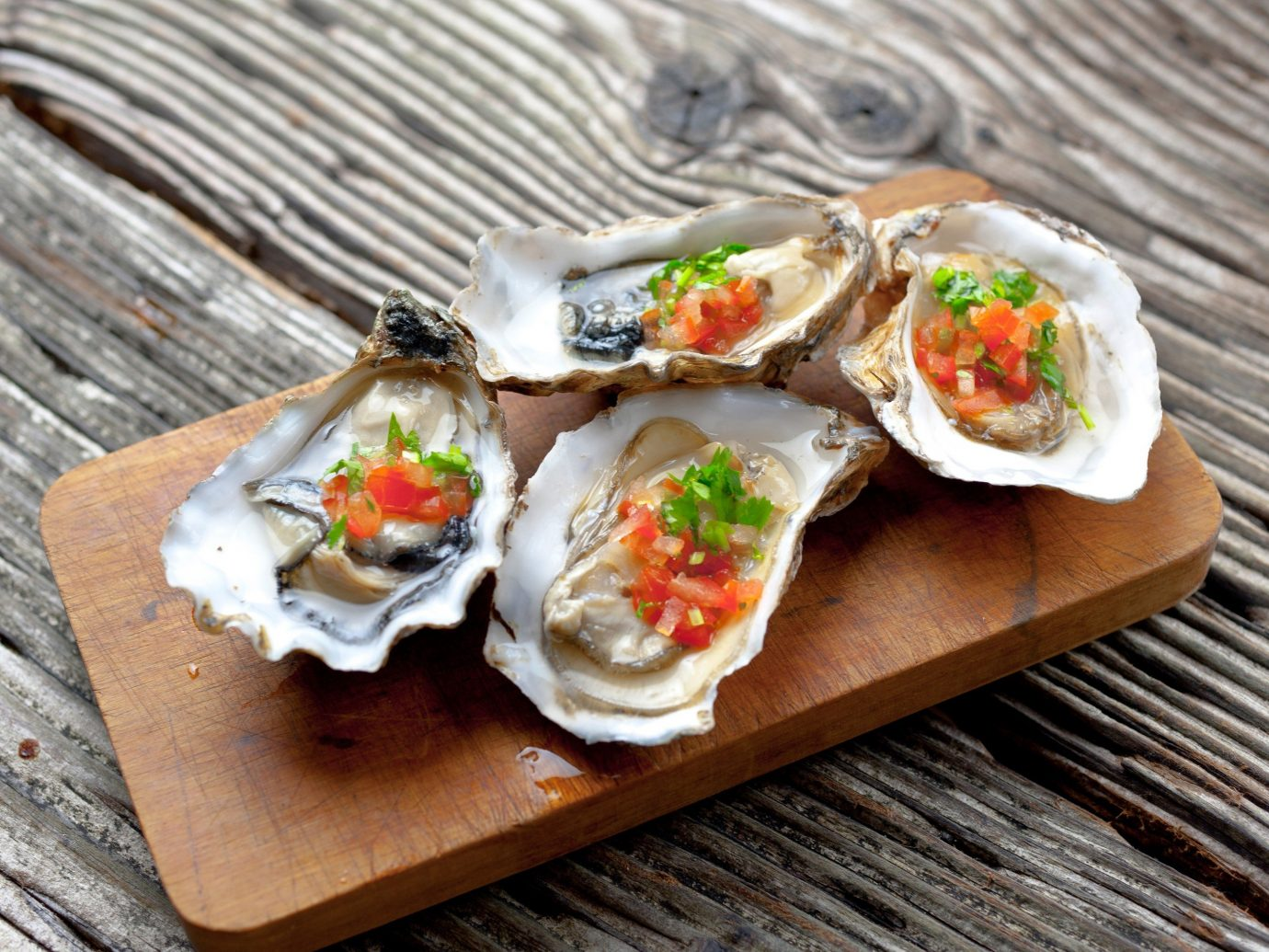 Trip Ideas wooden table food dish sushi Seafood oyster wood fish cuisine invertebrate mussel clams oysters mussels and scallops animal source foods hors d oeuvre