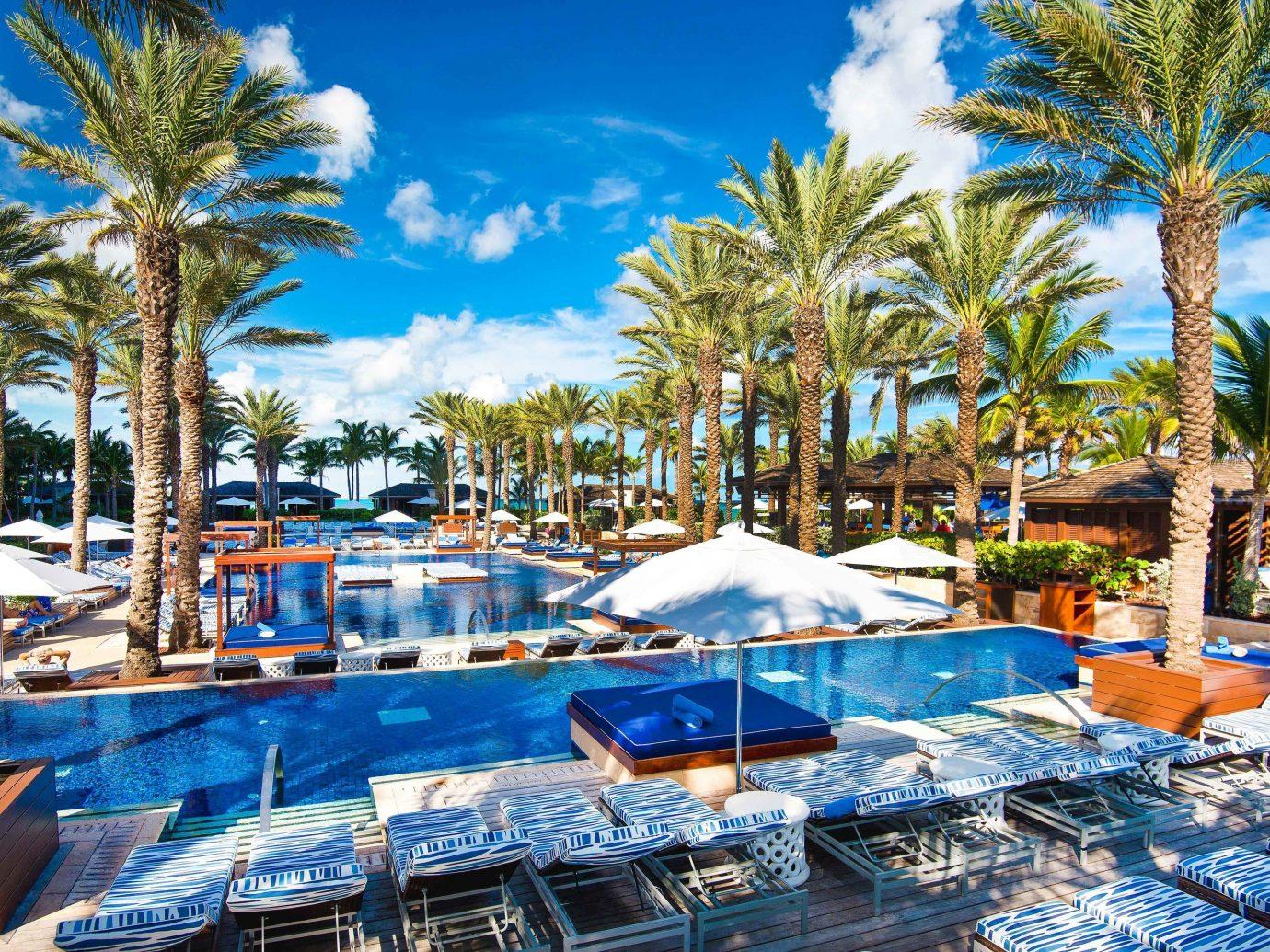 Beach Summer Travel Trip Ideas Resort swimming pool leisure resort town palm tree arecales vacation tourism hotel tree real estate estate tropics Villa caribbean recreation