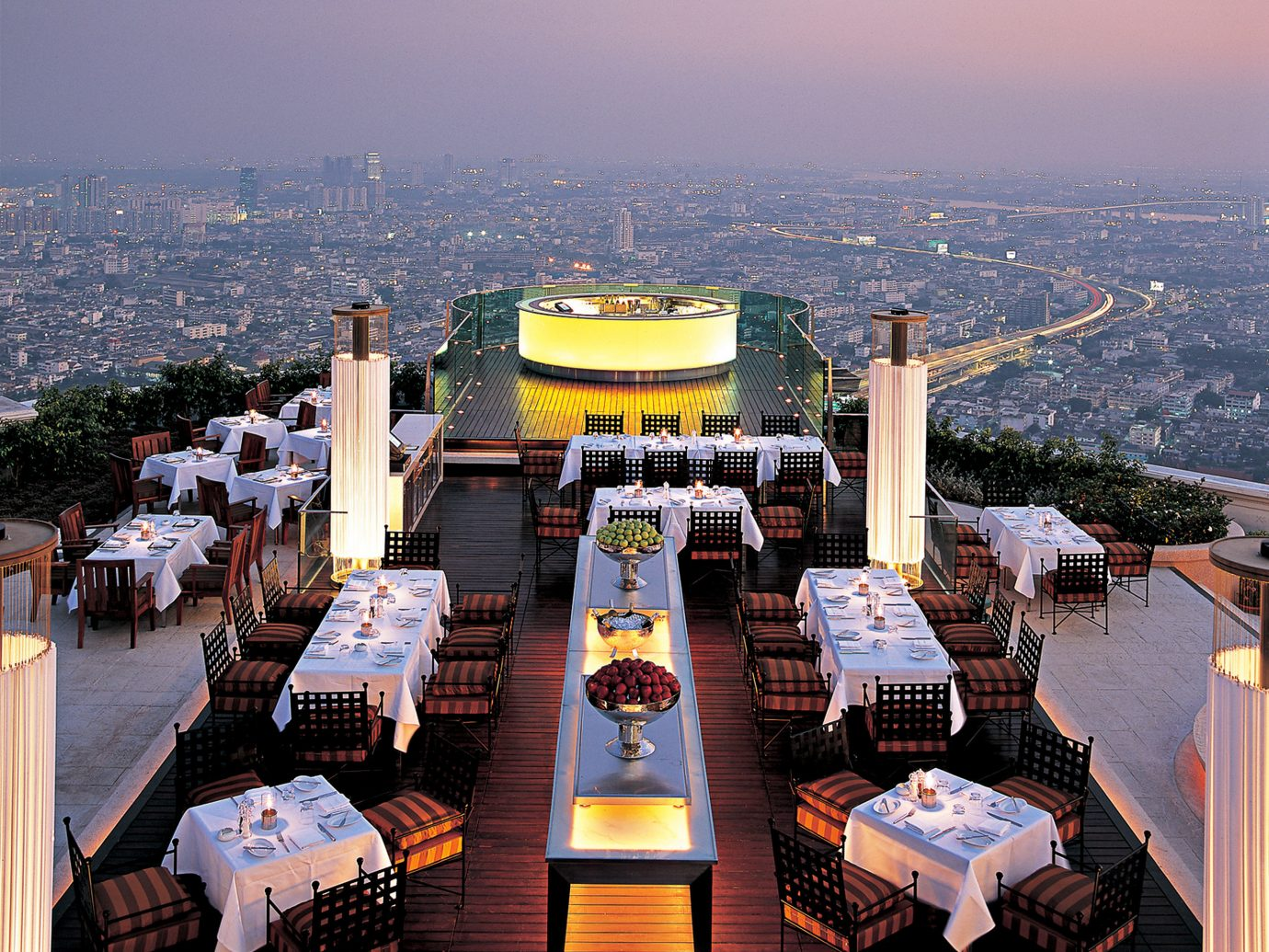 Bar Business City Dining Drink Eat Food + Drink Hotels Lounge Nightlife Party Rooftop Scenic views Trip Ideas sky mountain outdoor sport venue overlooking stadium cityscape vehicle Resort