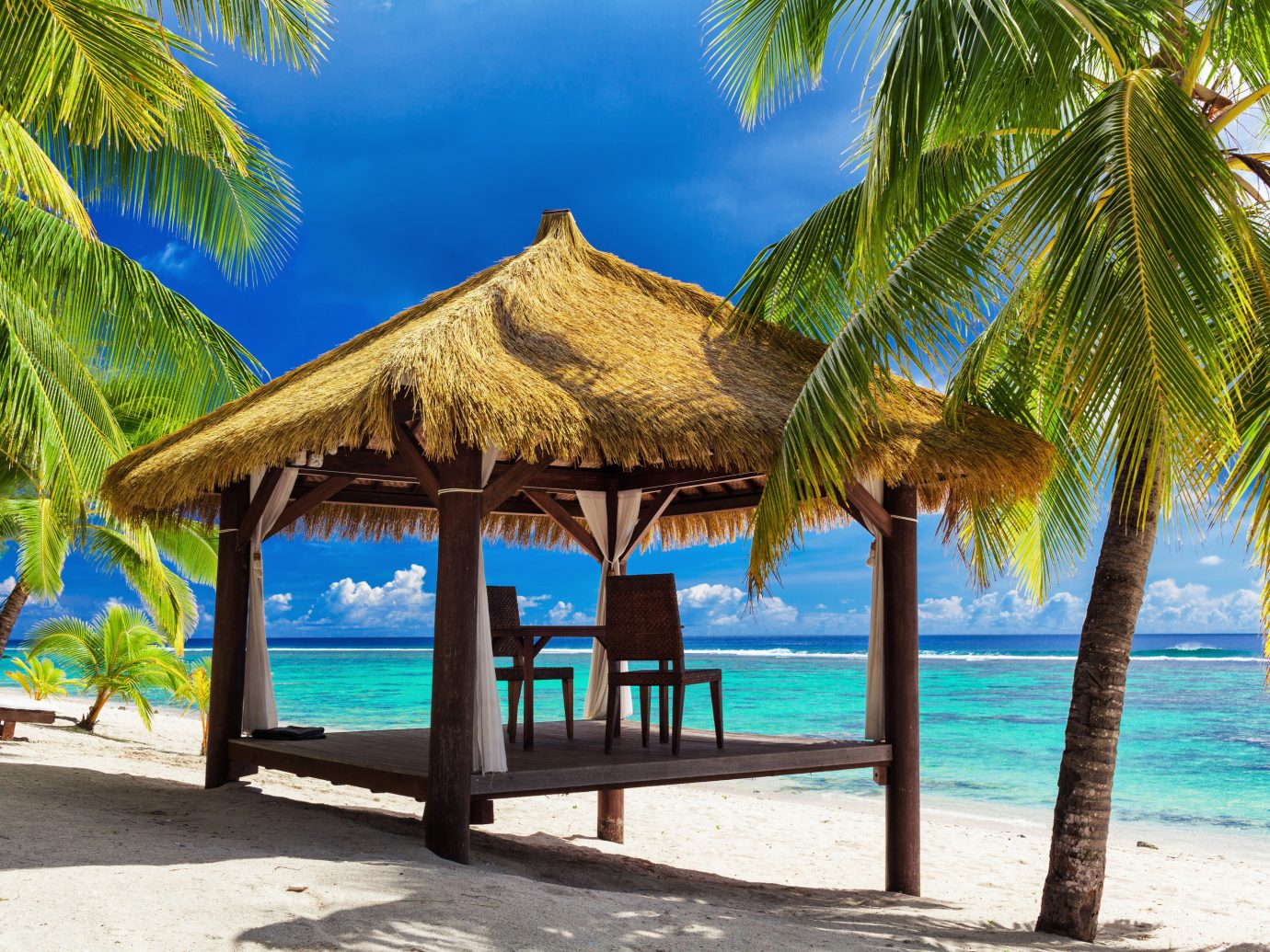 Islands Trip Ideas tree outdoor water palm Beach ground umbrella leisure chair geographical feature caribbean Pool Resort vacation tropics Ocean arecales tourism lined shade shore Sea estate Lagoon palm family Island empty plant sandy swimming