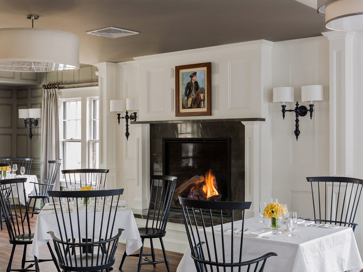 Boutique Classic Dining Drink Eat Fireplace Hotels Inn chair indoor floor room property dining room Kitchen home ceiling estate cottage interior design living room lighting real estate farmhouse hearth metal Villa cabinetry furniture area
