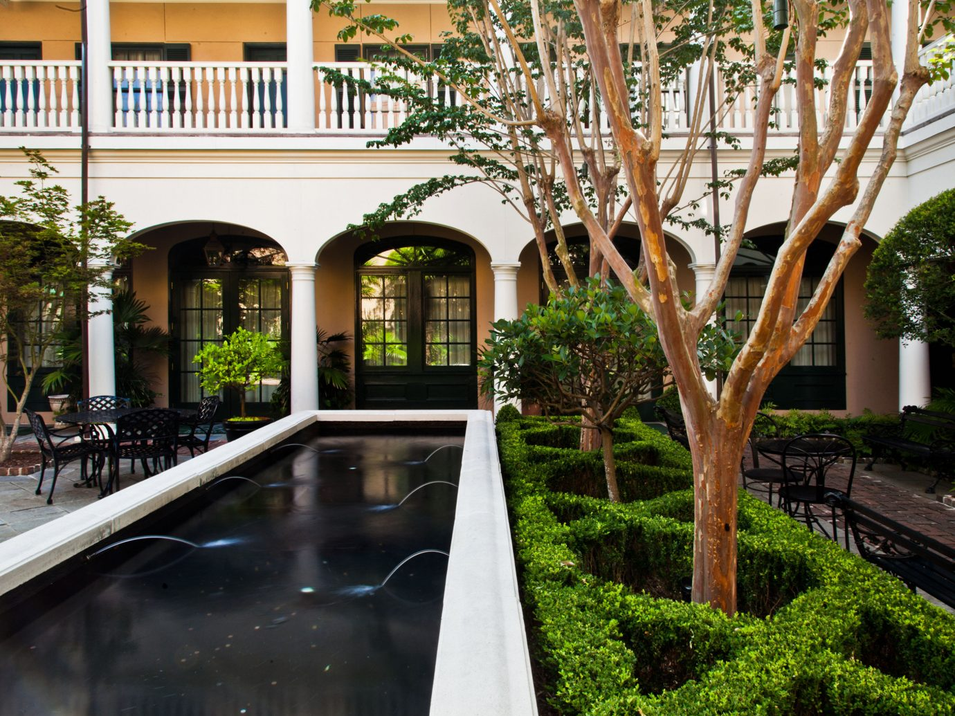 Elegant Exterior Fireplace Garden Grounds Hotels Inn Living Lobby Lounge Outdoors outdoor property estate house Courtyard home Architecture backyard Resort vacation swimming pool mansion condominium Villa yard flower outdoor structure