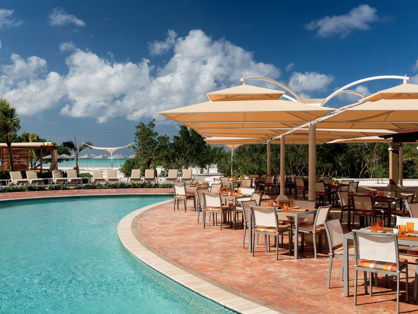 Aruba caribbean Hotels Trip Ideas sky chair outdoor table umbrella Resort swimming pool leisure real estate vacation resort town tourism estate outdoor structure hotel water Deck day several