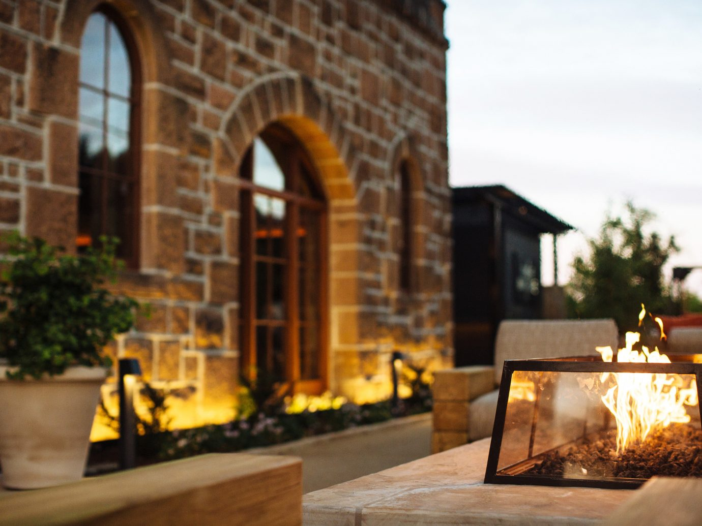 Trip Ideas building outdoor home lighting Courtyard Fireplace stone arch
