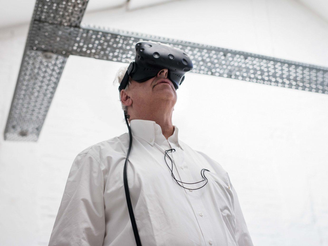 Arts + Culture Trip Ideas person man eyewear wearing professional standing vision care hat gentleman
