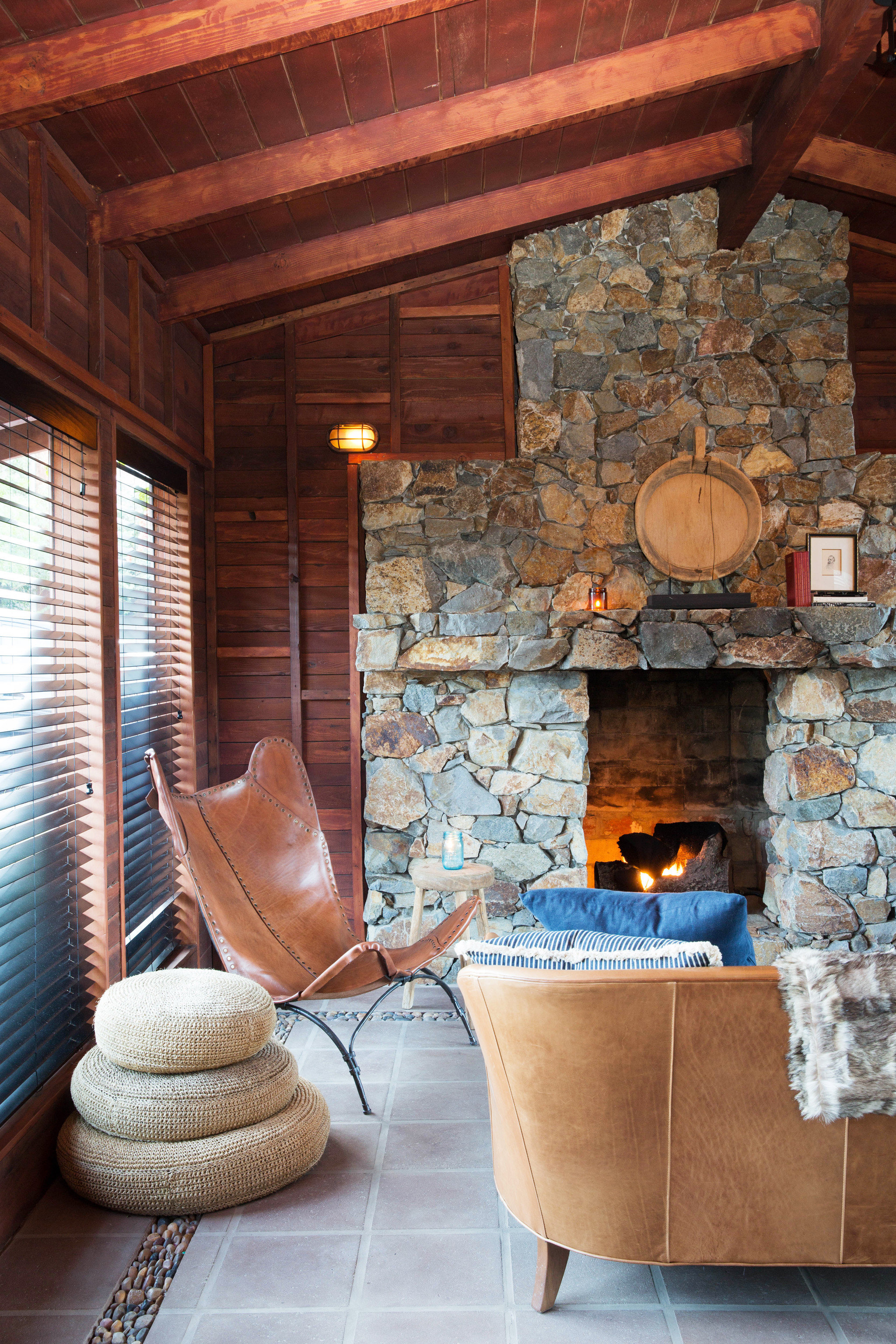 Jetsetter Guides indoor floor Fireplace Living room living room wall home wood hardwood cottage interior design log cabin hearth estate farmhouse furniture stone
