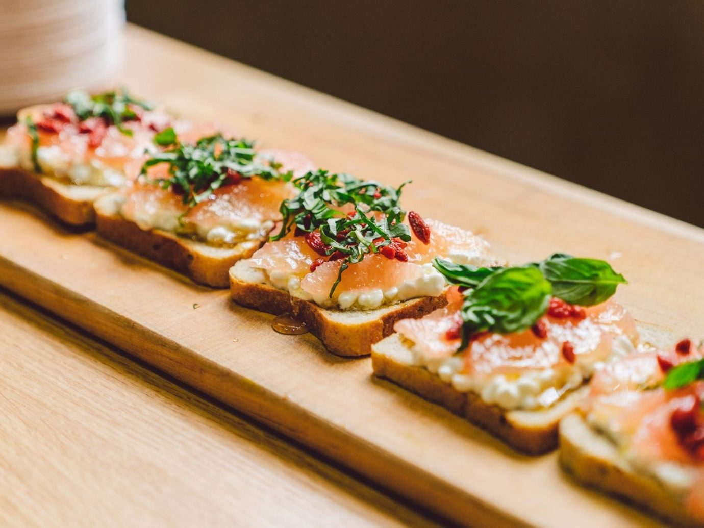 Trip Ideas food table dish indoor appetizer slice cuisine piece wooden sushi finger food hors d oeuvre canapé recipe bruschetta square