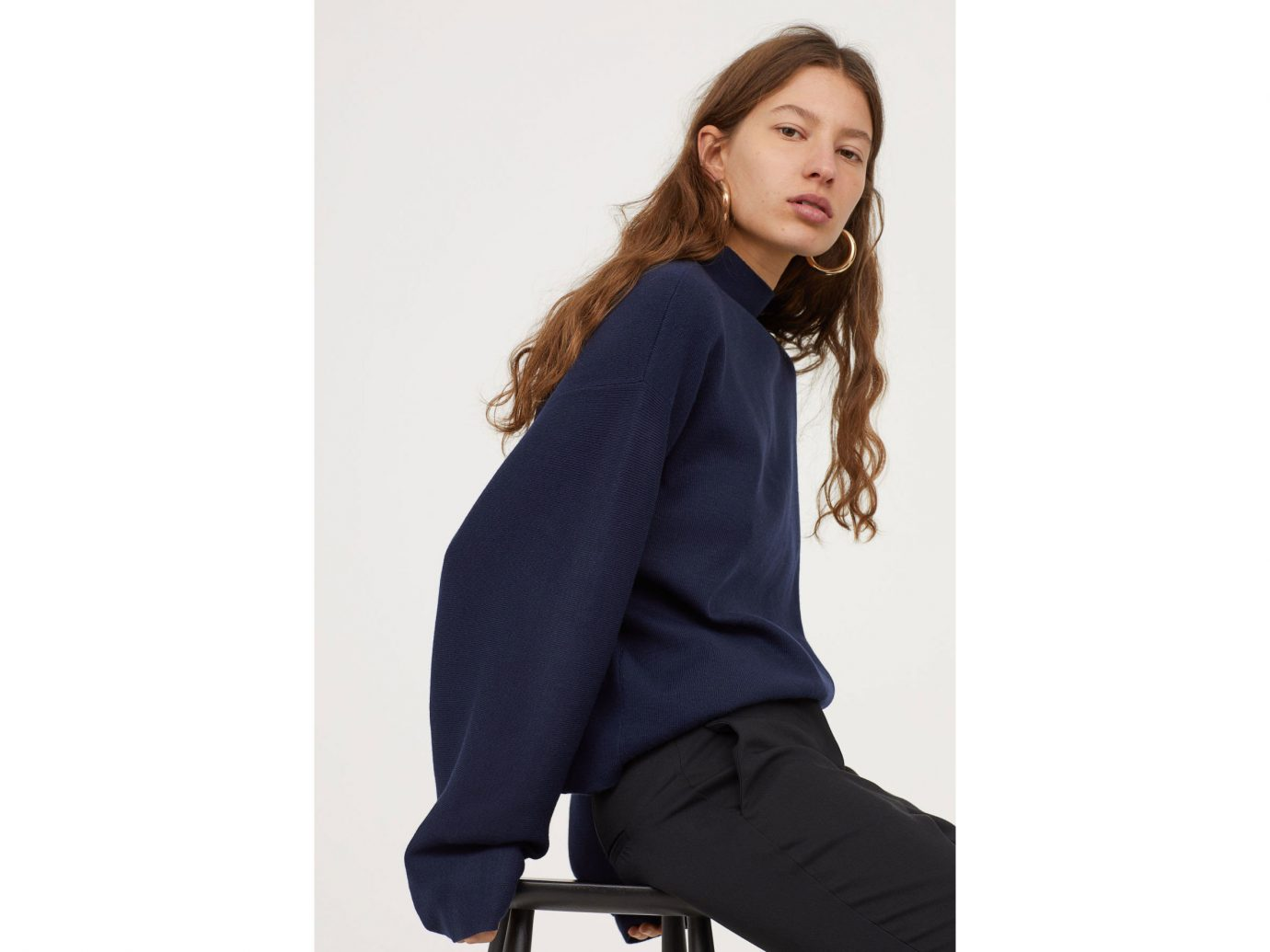 City NYC Style + Design Travel Shop person clothing sitting shoulder outerwear coat blazer sleeve neck posing jacket top formal wear trouser