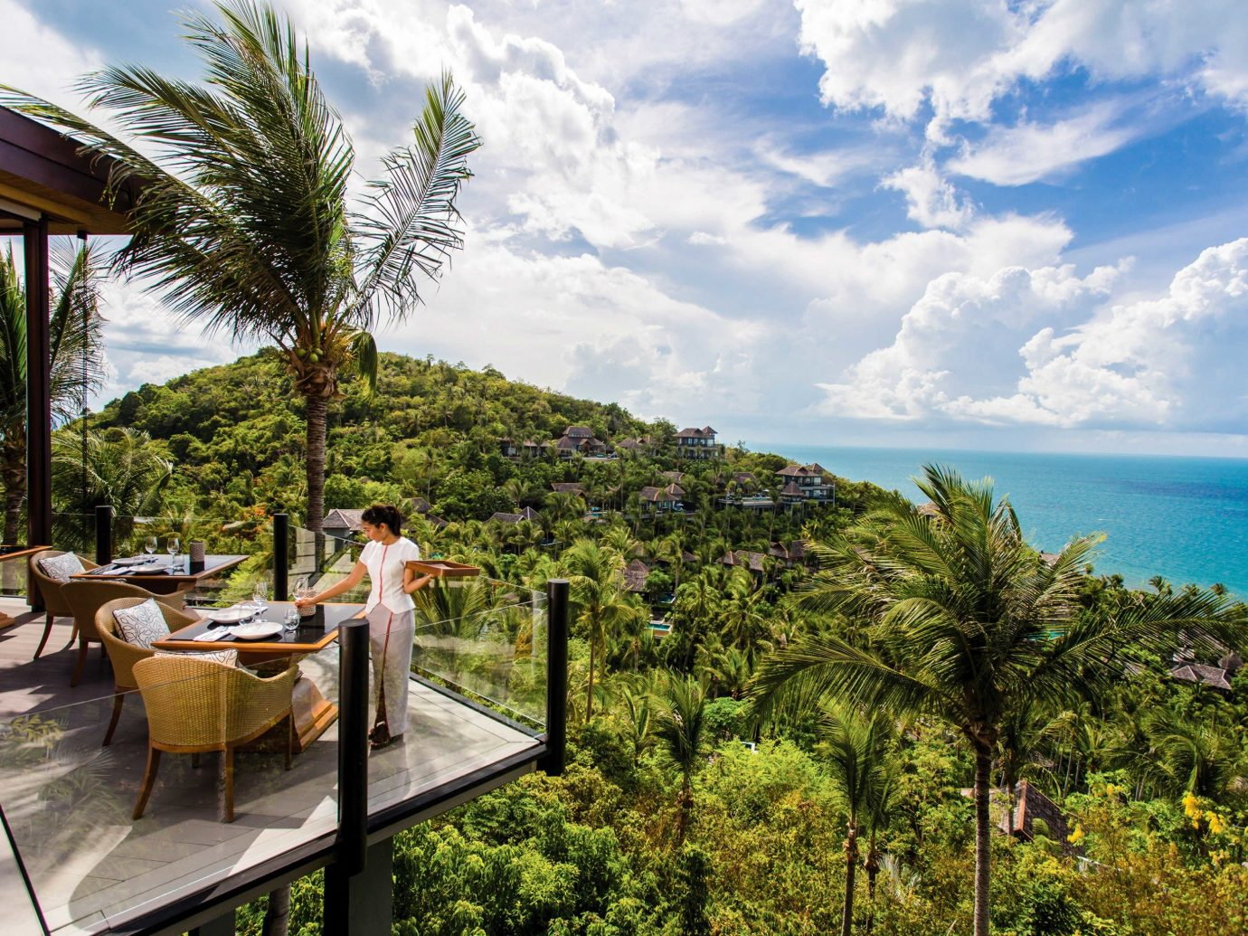 Hotels tree sky outdoor Resort palm tree arecales tropics Sea vacation real estate leisure tourism Ocean plant estate Beach caribbean water Coast overlooking area