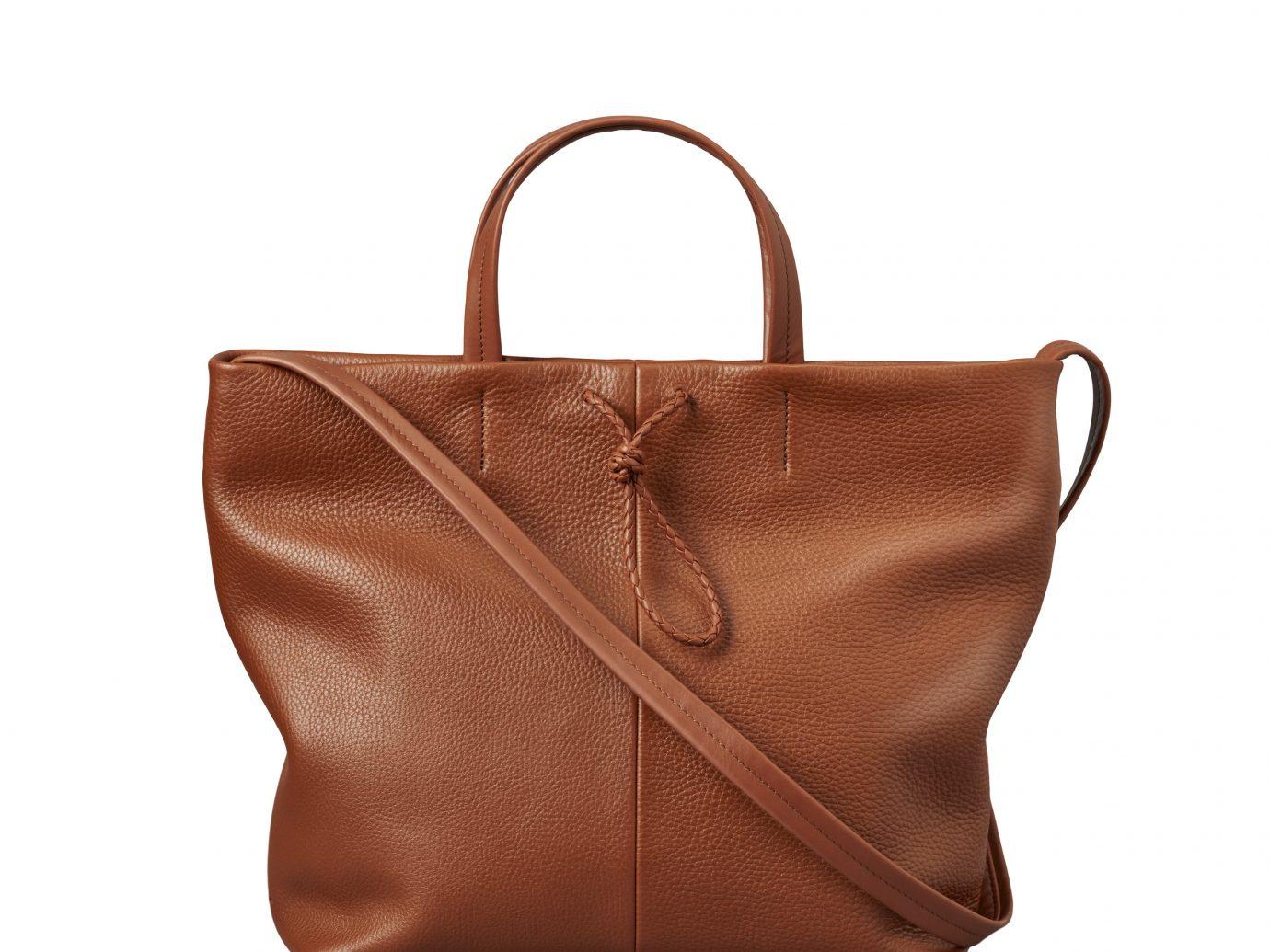Arts + Culture Boutique Hotels City Jetsetter Guides handbag bag brown accessory leather shoulder bag fashion accessory caramel color product tote bag product design peach beige brand case
