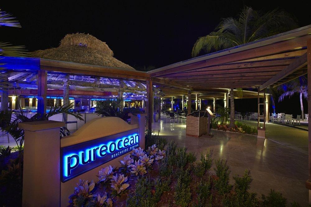 night evening Resort sign