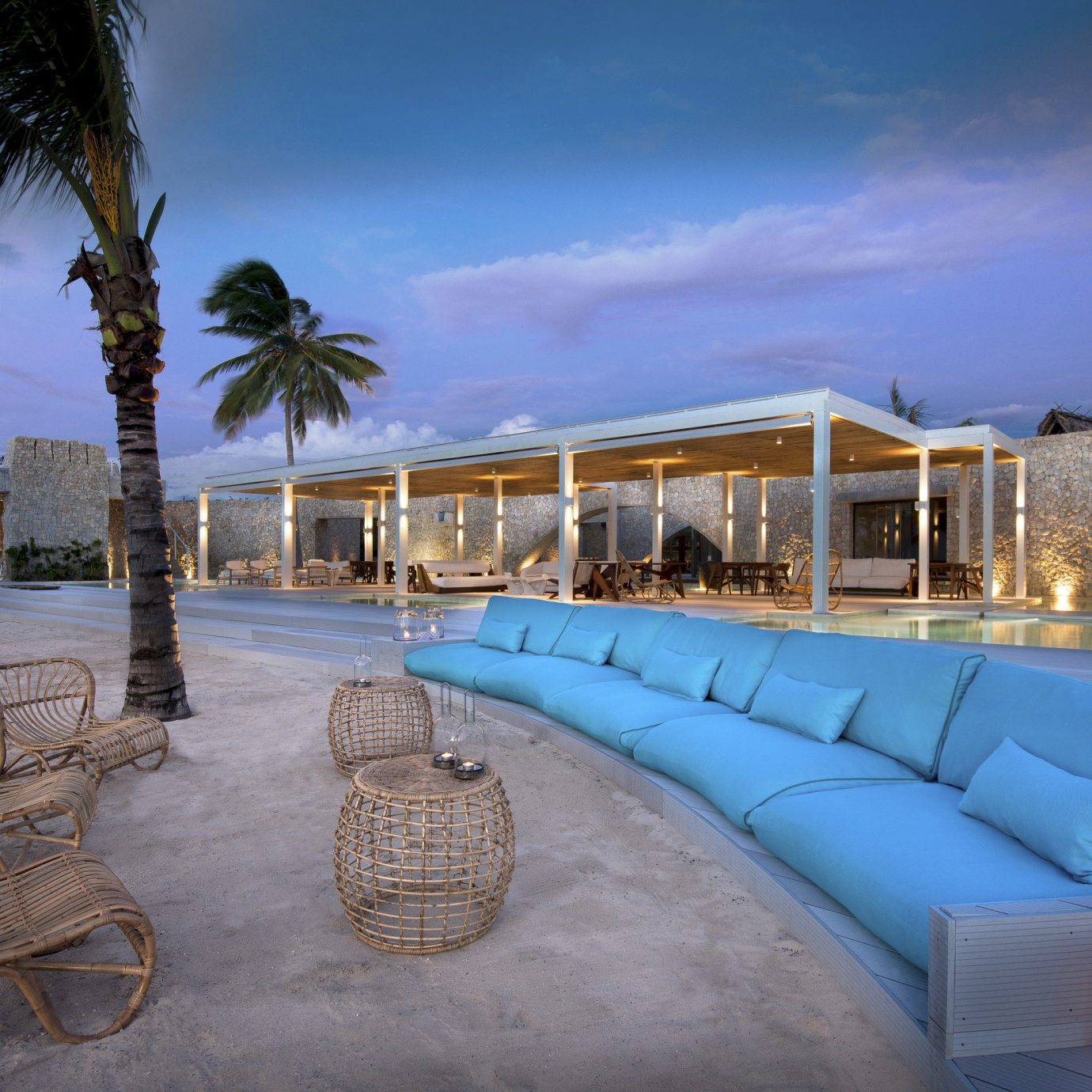 sky Resort property palm tree swimming pool arecales home resort town Villa caribbean leisure evening hacienda tropics lined sandy shore
