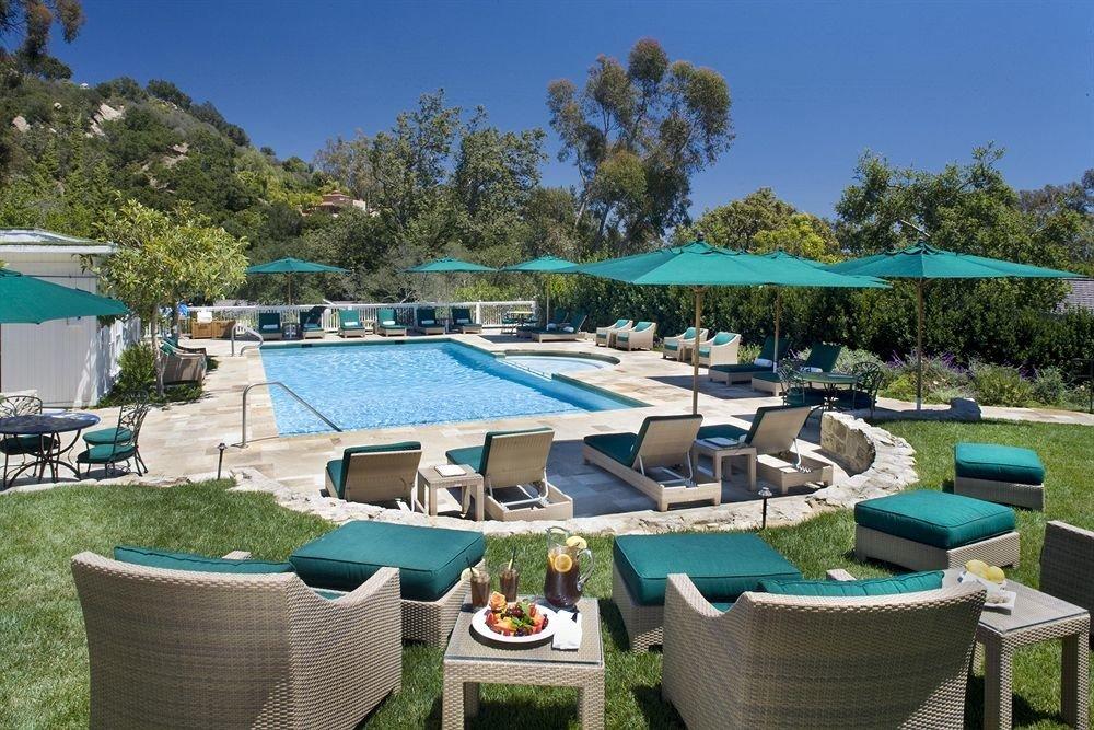 tree sky chair green property swimming pool leisure Resort Villa blue backyard lawn set cottage colorful