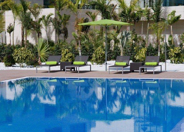 swimming pool property condominium Resort reflecting pool Villa backyard home landscape architect