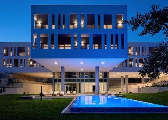 building grass property condominium leisure leisure centre Resort home plaza blue mansion convention center Villa headquarters