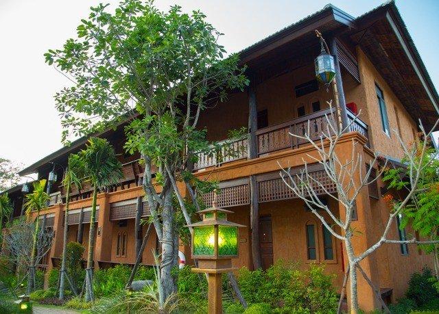 tree building property house Resort home Villa cottage eco hotel hacienda Village residential