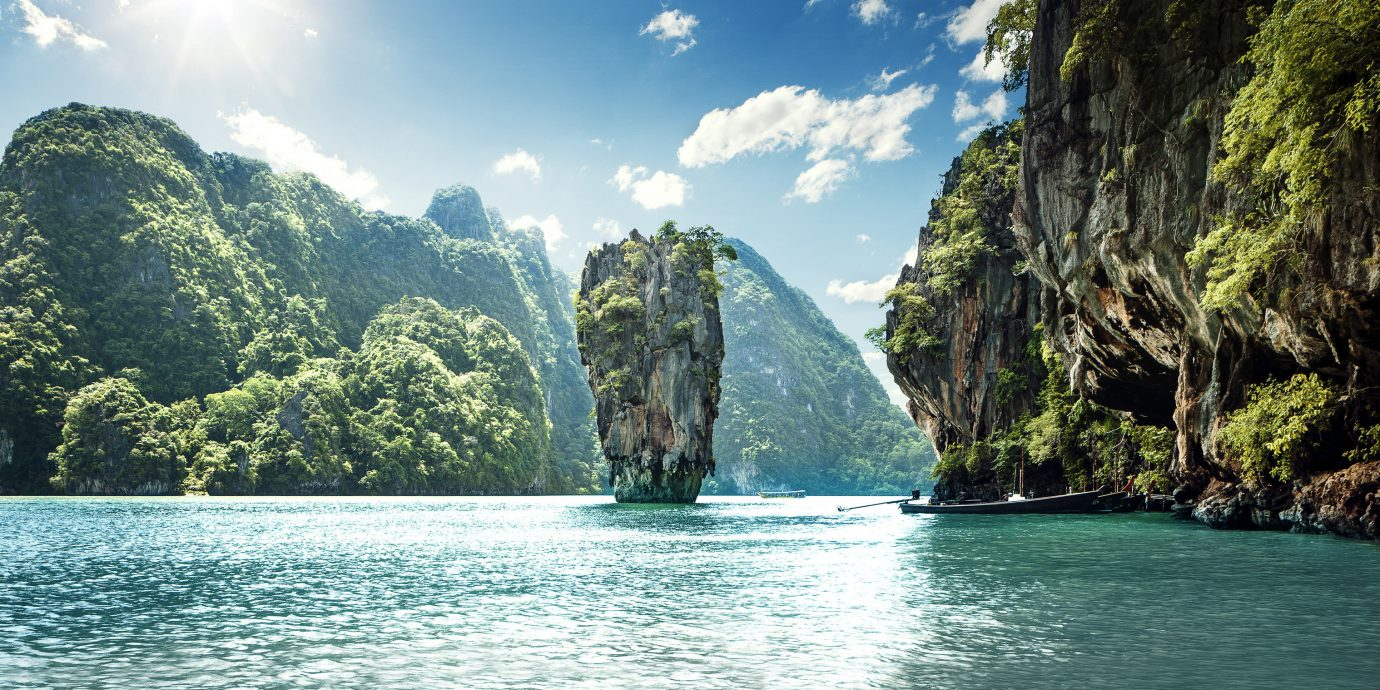 Jetsetter Guides Offbeat outdoor water tree mountain Nature geographical feature landform body of water Lake bay Sea River rock Coast tropics cliff Lagoon terrain Island national park islet surrounded day hillside