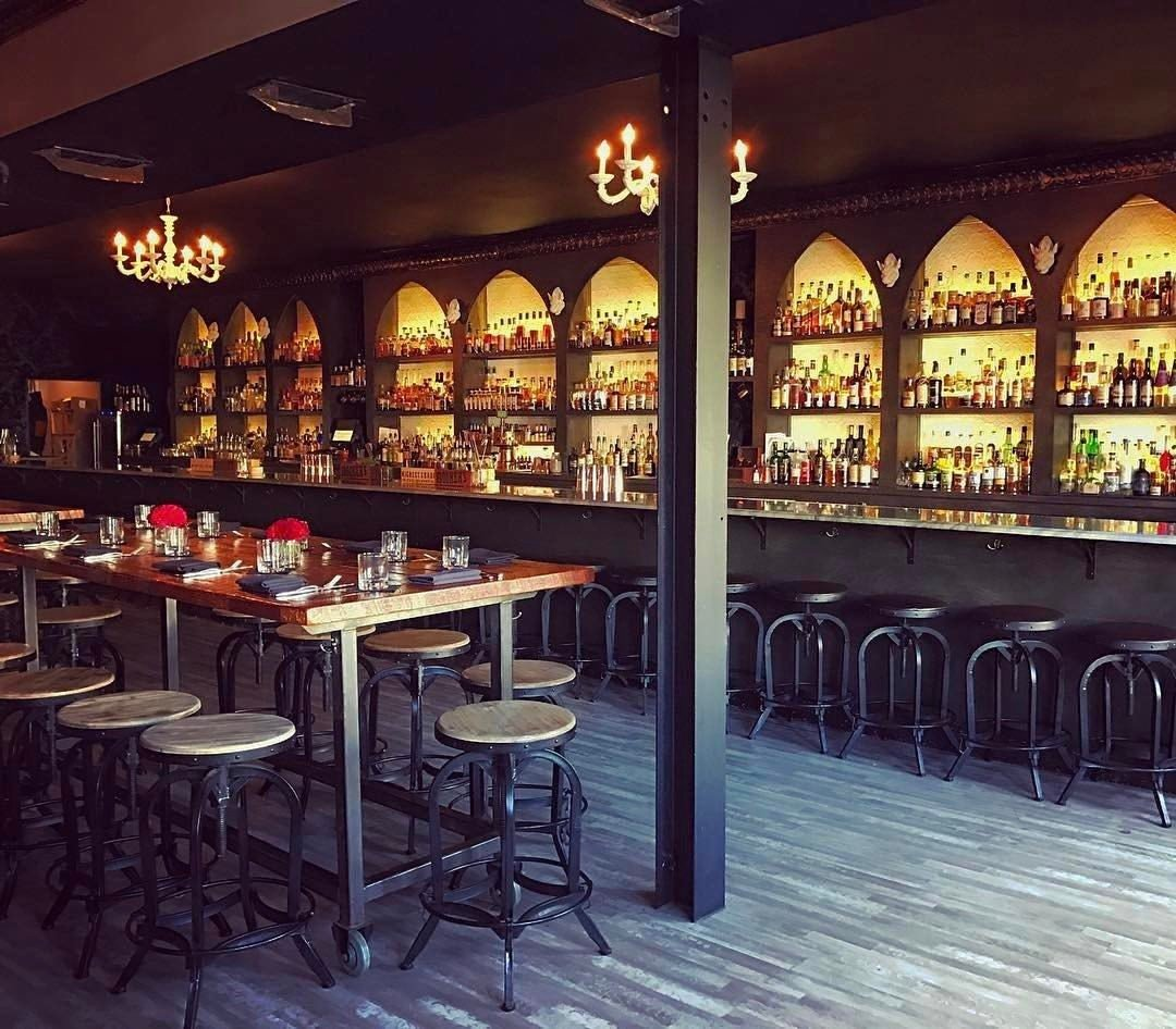 Food + Drink ceiling floor Bar tavern pub liquor store restaurant table café interior design dining room