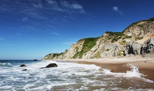 Trip Ideas sky water outdoor Nature Coast mountain shore landform Beach wind wave Sea Ocean wave bay cliff cape cove terrain rock promontory