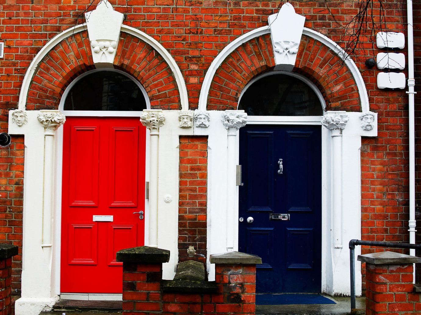 Offbeat building brick outdoor color red door sidewalk arch parked Architecture facade window stone interior design step chapel doorway curb