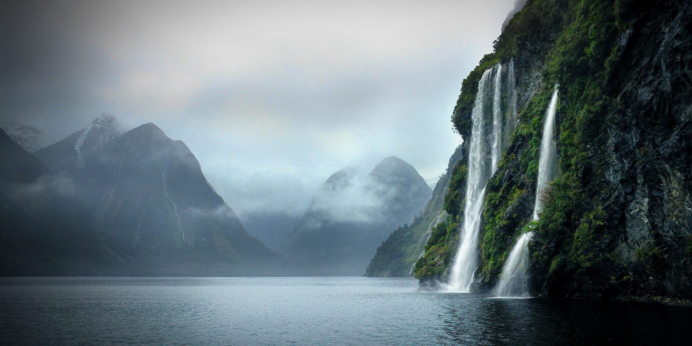 Hotels Offbeat Trip Ideas Nature water outdoor mountain atmospheric phenomenon Waterfall body of water water feature mist fjord reflection Lake Sea distance
